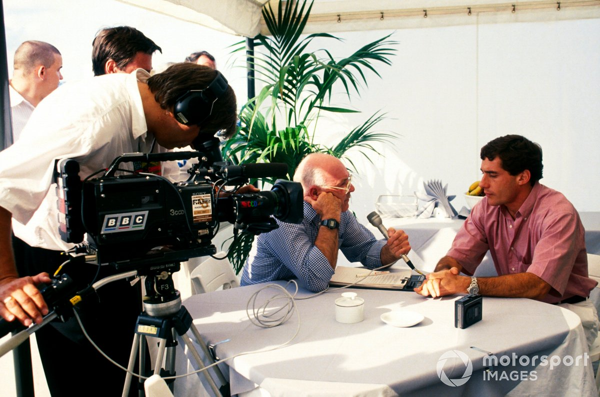 Ayrton Senna, McLaren, who crashed out on the opening lap of the race, is interviewed by Murray Walker, Television Commentator for the BBC.