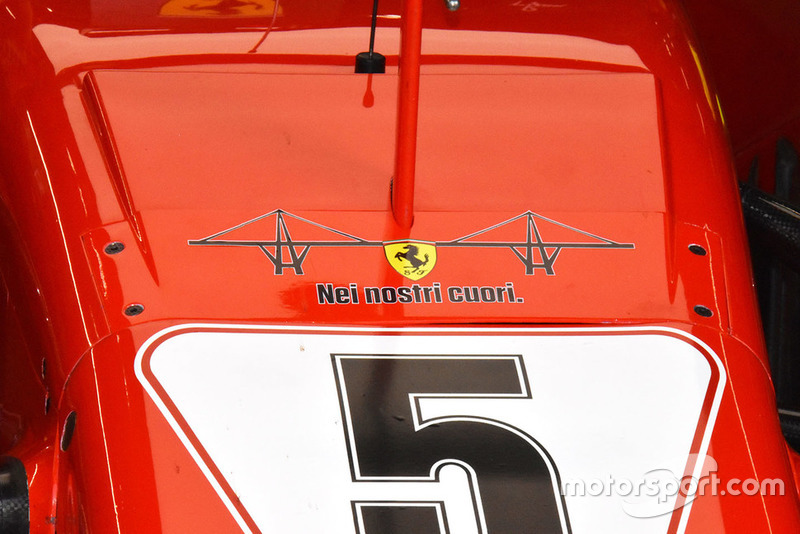 """Ferrari SF71H with the emblem of Genoa's collapsed bridge and the message """"In our hearts"""""""