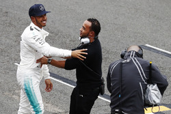Lewis Hamilton, Mercedes AMG F1, is congratulated on his pole position by his brother Nick