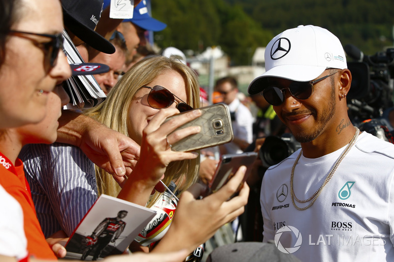 Lewis Hamilton, Mercedes AMG F1, poses for a fan to take a photo
