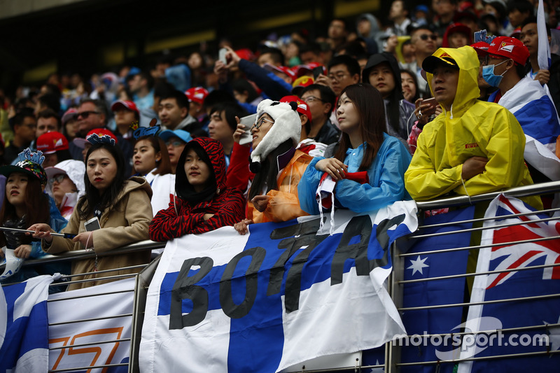 Fan of Valtteri Bottas, Mercedes AMG, in a Panda hat in the grandstand