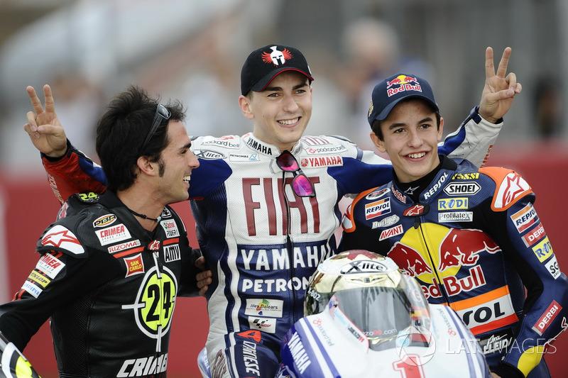 Toni Elias, Jorge Lorenzo y Marc Márquez, campeones del mundo de Moto2, MotoGP y 125cc, respectivamente, en 2010.