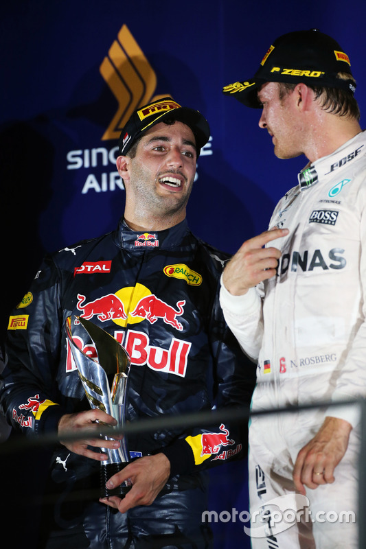 (L to R): second placed Daniel Ricciardo, Red Bull Racing and race winner Nico Rosberg, Mercedes AMG F1 on the podium