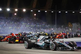 Lewis Hamilton, Mercedes AMG F1 W09 EQ Power+, leads Sebastian Vettel, Ferrari SF71H at the start of the race