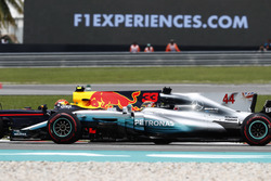 Lewis Hamilton, Mercedes AMG F1 W08, battles, Max Verstappen, Red Bull Racing RB13, for the lead