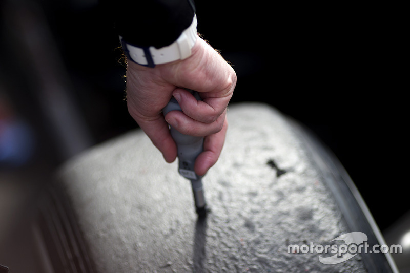 A Pirelli technician checking tyre temperatures