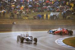 Jacques Villeneuve, Williams FW18; Michael Schumacher, Ferrari F310; Jean Alesi, Benetton B196