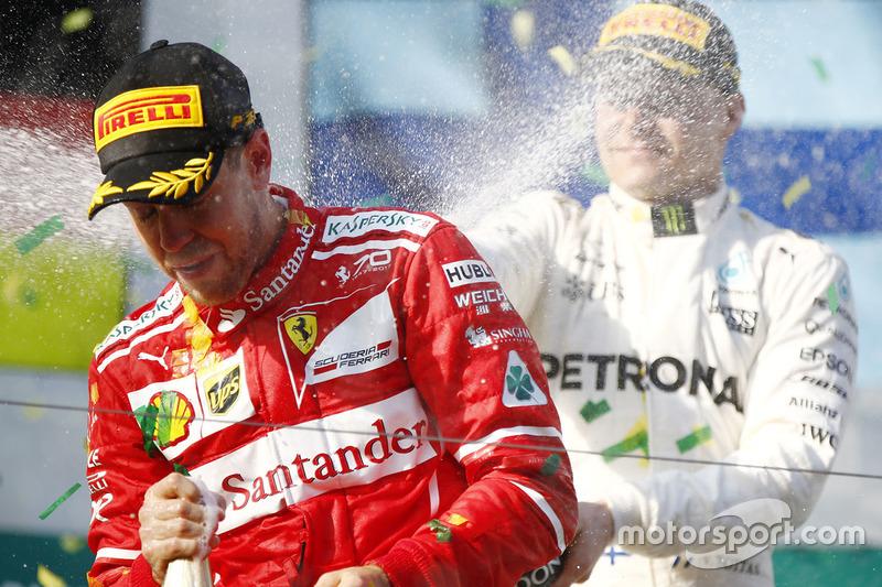 Sebastian Vettel, Ferrari; Valtteri Bottas, Mercedes AMG F1