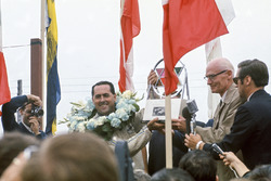 Jack Brabham, Brabham BT24-Repco, celebrates victory on the podium