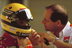 Ayrton Senna, McLaren Honda, prepares to qualify under the watchful eye of McLaren team boss Ron Dennis