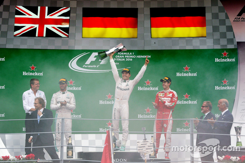 The podium (L to R): Lewis Hamilton, Mercedes AMG F1, second; Nico Rosberg, Mercedes AMG F1, race winner; Sebastian Vettel, Ferrari, third