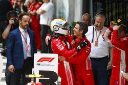 Race winner Sebastian Vettel, Ferrari, celebrates on arrival in Parc Ferme with Inaki Rueda, Race Strategist, Ferrari