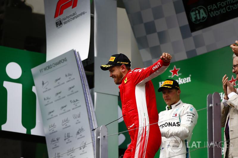 Sebastian Vettel, Ferrari, 1st position, celebrates as he arrives on the podium