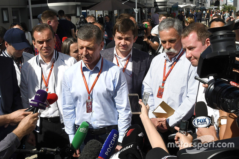 Veniamin Kondrytyev, Governor of Krasnodar Region, Dmitry Kozak, Deputy Prime Minister of the Russian Federation,  Sergey Vorobyev, Sochi Autodrom Deputy General Director and Chase Carey, Chief Executive Officer and Executive Chairman of the Formula One Group talk, the media
