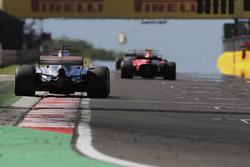 Lewis Hamilton, Mercedes AMG F1 W08, chases Kimi Raikkonen, Ferrari SF70H