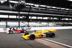 Johnny Rutherford, McLaren M16, and Mario Andretti, McLaren M24