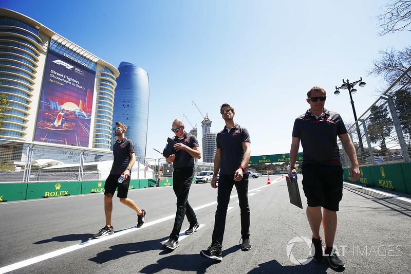 Romain Grosjean, Haas F1 Team VF-18 Ferrari, walks the circuit with his team