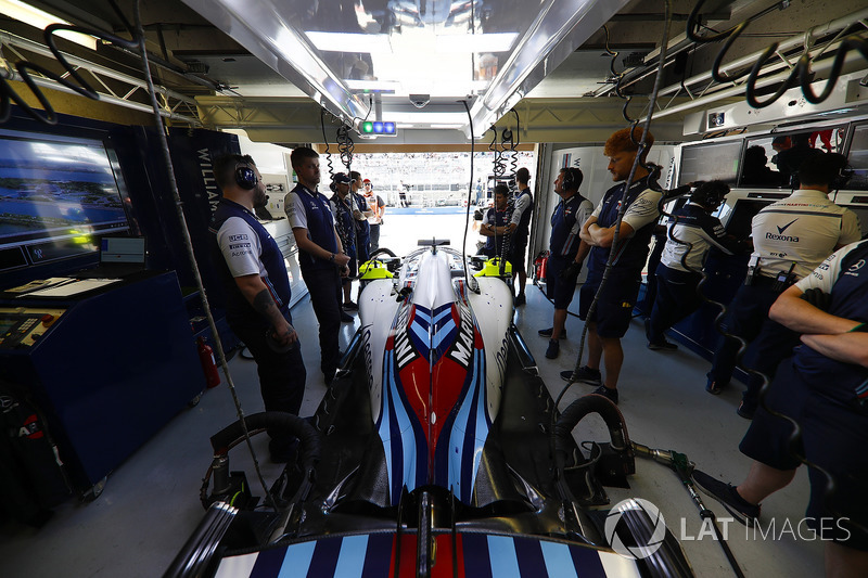 Mechanics attend the Lance Stroll Williams FW41 in the team's garage.