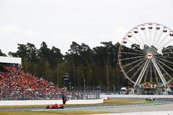 Sebastian Vettel, Ferrari SF71H, leads Charles Leclerc, Sauber C37