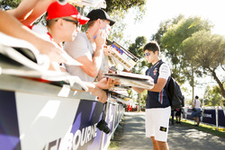 Lance Stroll, Williams Racing, signs an autograph