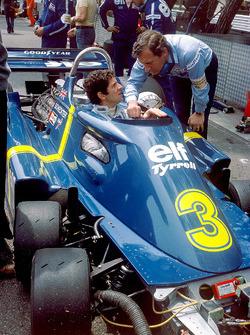 Jody Scheckter, Tyrrell P34-Ford Cosworth, talks with designer Derek Gardner, in the pit lane