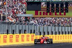 Sebastian Vettel, Ferrari SF70H, race winner, takes the chequered flag