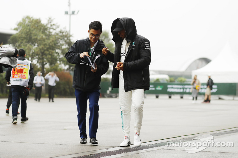 Lewis Hamilton, Mercedes AMG, signs an autograph for a fan