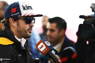 Fernando Alonso, McLaren, talks to the media.
