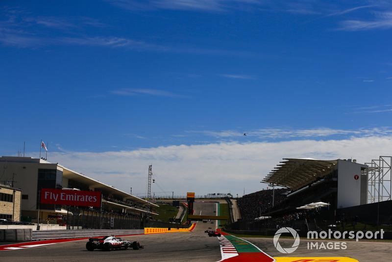 Sebastian Vettel, Ferrari SF71H, leads Kevin Magnussen, Haas F1 Team VF-18