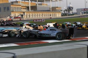 Michael Schumacher, Mercedes GP MGP W01 spins and collects Vitantonio Liuzzi, Force India VJM03