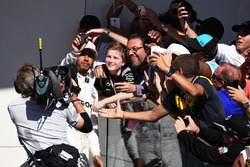 Race winner Lewis Hamilton, Mercedes AMG F1 celebrates on the podium with the fans and poses for a selfie