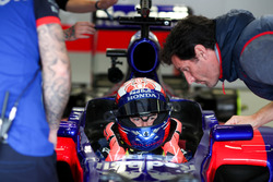 Marc Marquez, tests the Toro Rosso F1 car with Mark Webber watching