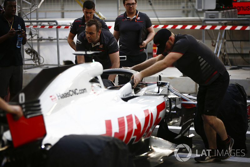 Romain Grosjean, Haas F1 Team VF-18 Ferrari, been pushed back into the garage