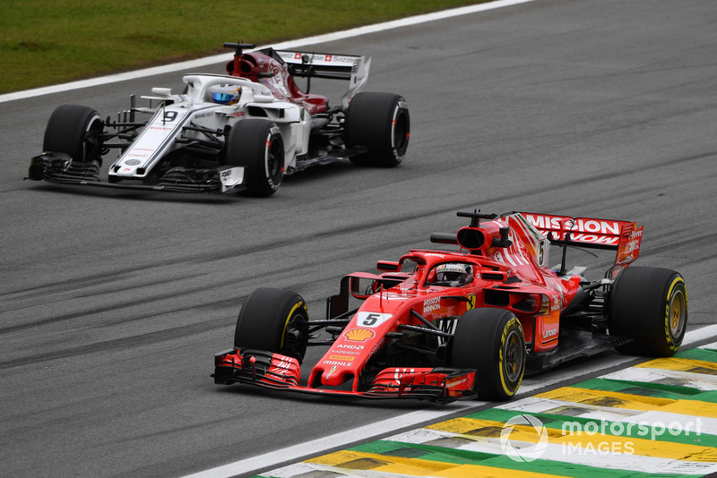 Sebastian Vettel, Ferrari SF71H and Marcus Ericsson, Sauber C37