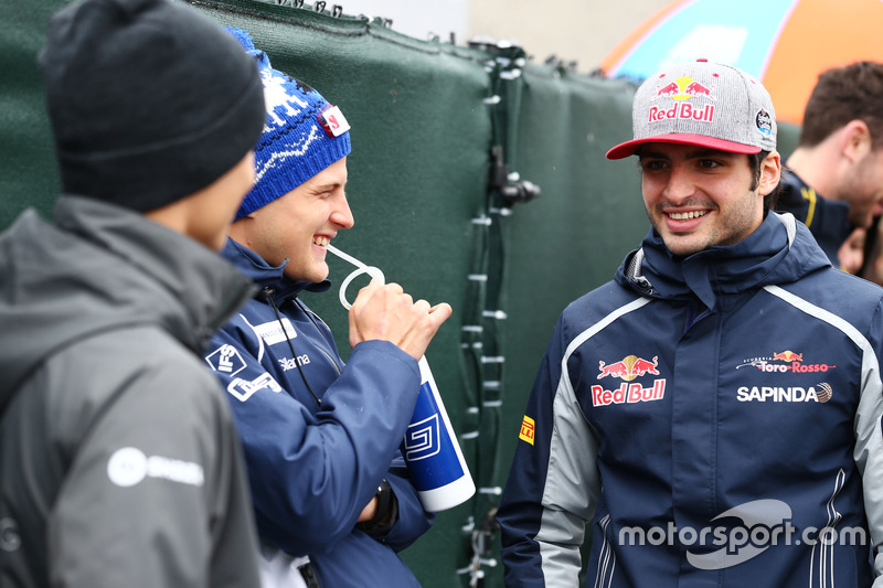 (Зліва направо): Маркус Ерікссон, Sauber F1 Team та Карлос Сайнс-молодший, Scuderia Toro Rosso