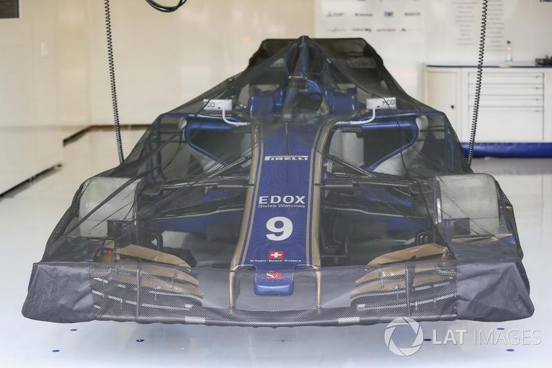Sauber C36 under covers in the garage