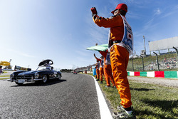 Marshals line the track as Lewis Hamilton, Mercedes AMG F1, passes in the drivers parade