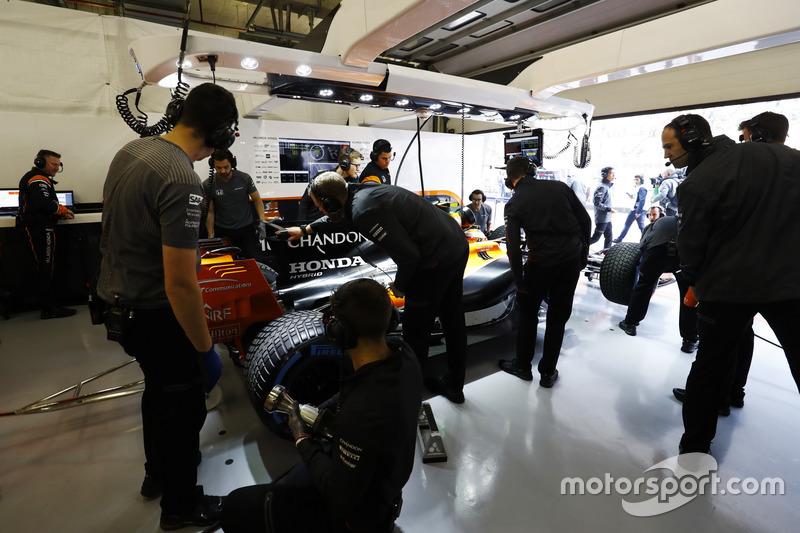 Engineers at work in the McLaren garage