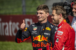 Race winner Max Verstappen, Red Bull Racing and Sebastian Vettel, Ferrari celebrate in parc ferme