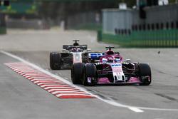 Sergio Perez, Force India VJM11 Mercedes, leads Romain Grosjean, Haas F1 Team VF-18 Ferrari