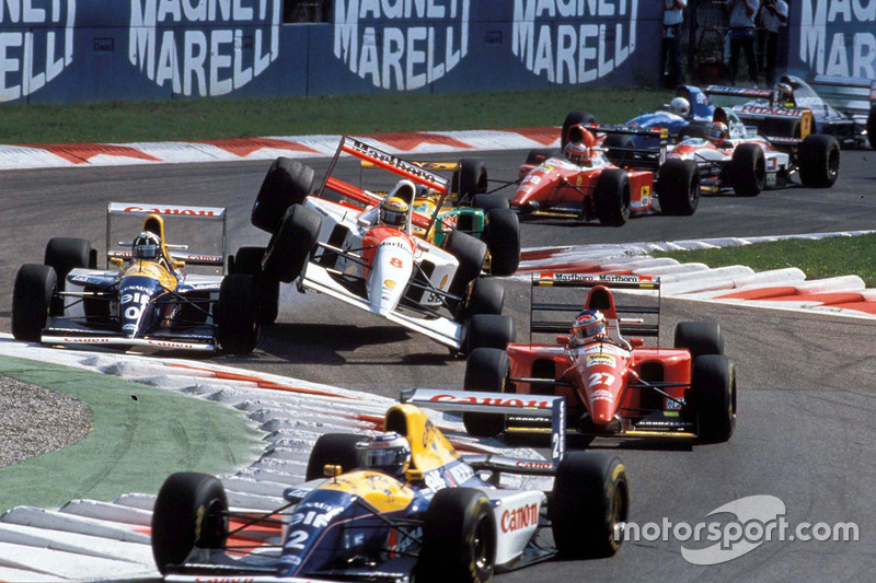 Italian GP start action: Alain Prost leads Jean Alesi as Ayrton Senna flies over Damon Hill