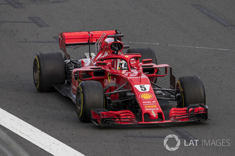 Sebastian Vettel, Ferrari SF71H, 1st position, punches the air in celebration after crossing the finish line