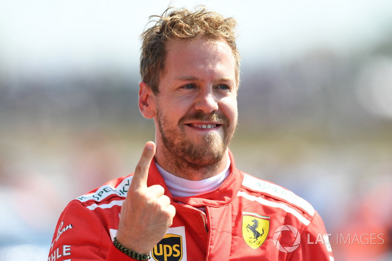 Il vincitore della gara Sebastian Vettel, Ferrari SF71H, festeggia nel parco chiuso