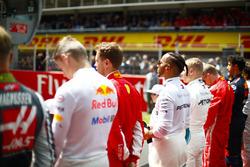 Max Verstappen, Red Bull Racing, Sebastian Vettel, Ferrari, Lewis Hamilton, Mercedes AMG F1, and Valtteri Bottas, Mercedes AMG F1, on the grid for the national anthem