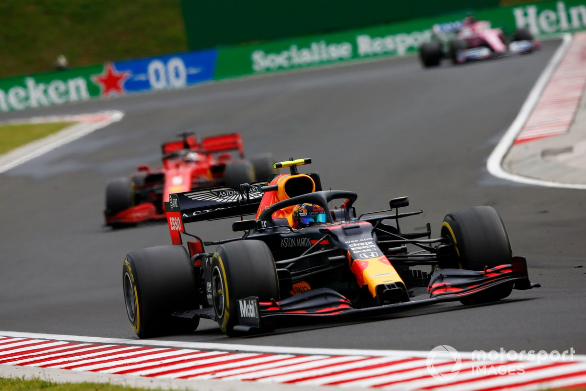 Alex Albon, Red Bull Racing RB16, leads Sebastian Vettel, Ferrari SF1000