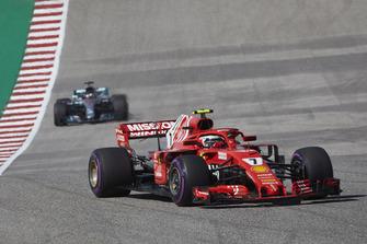 Kimi Raikkonen, Ferrari SF71H, leads Lewis Hamilton, Mercedes AMG F1 W09 EQ Power+
