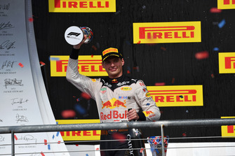 Max Verstappen, Red Bull Racing celebrates with the trophy and the champagne on the podium