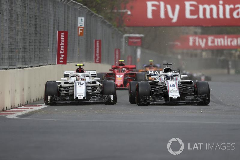 Charles Leclerc, Sauber C37, Lance Stroll, Williams FW41 battle