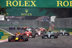 Max Verstappen, Red Bull Racing RB13 leads at the start of the race with Lewis Hamilton, Mercedes-Benz F1 W08  and rear puncture after colliding with Sebastian Vettel, Ferrari SF70H