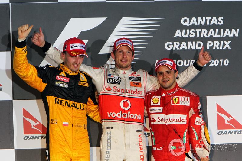 Podio: segundo puesto Robert Kubica, Renault F1 Team, ganador de la carrera Jenson Button, McLaren,